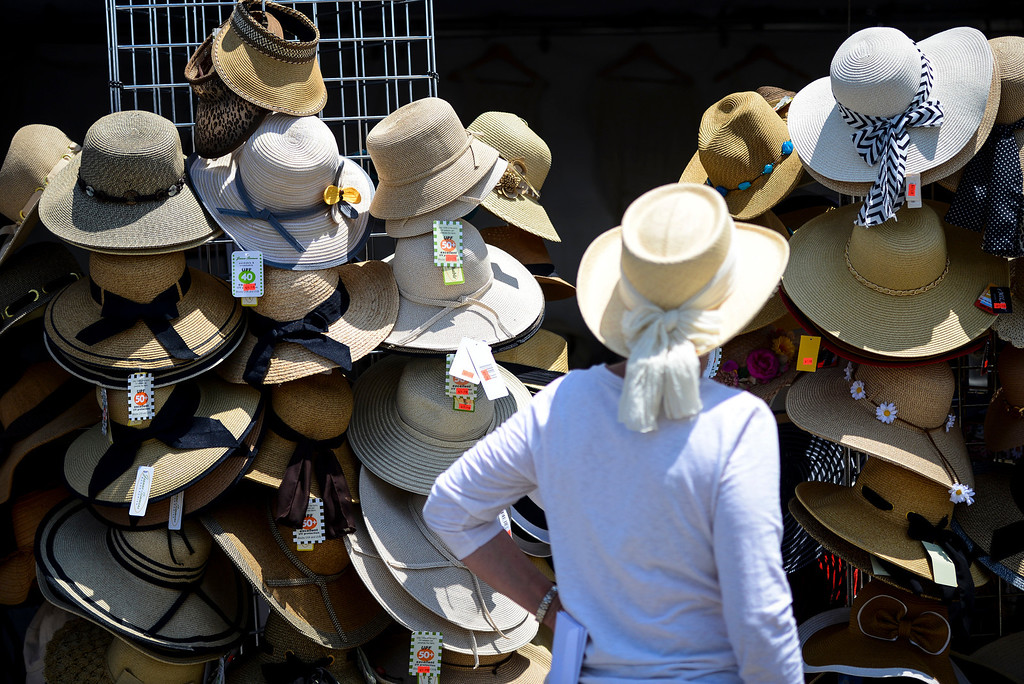 . Hat shopping at the 41st annual valley Greek Festival at the Saint Nicholas Greek Orthodox Church at the corner of Balboa and Plummer streets in Northridge.  The festival runs through Monday with food, music, dancing and crafts.   ( Photo by David Crane/Los Angeles Daily News )