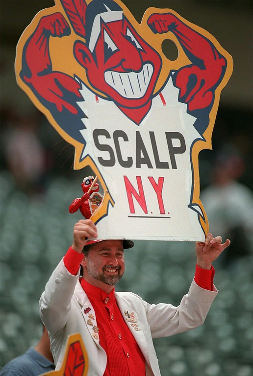 . Indians fan Jim Stamper shows a Chief Wahoo sign prior to game 3 of the AL Division Series at Jacobs Field in Cleveland, Saturday Oct. 4, 1997. The series between the Indians and the New York Yankees stands at 1-1. (AP Photo/Tony Dejak)