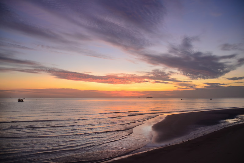Colourful pink and gray cirrostratus cloudy sea water tropical sunrise seascape.