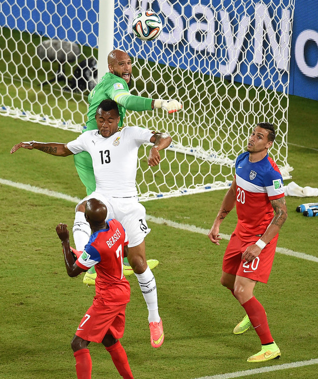 . US goalkeeper Tim Howard (L) jumps for the ball behind Ghana\'s forward Jordan Ayew (C) during a Group G football match between Ghana and US at the Dunas Arena in Natal during the 2014 FIFA World Cup on June 16, 2014.  JAVIER SORIANO/AFP/Getty Images