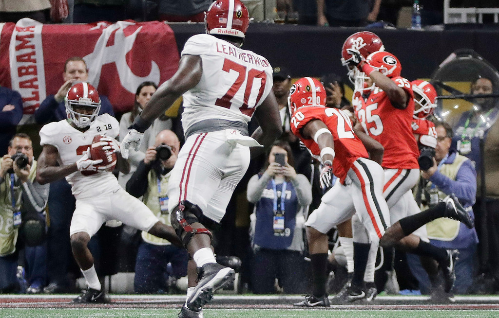 . Alabama\'s Calvin Ridley catches a touchdown pass during the second half of the NCAA college football playoff championship game against Georgia Monday, Jan. 8, 2018, in Atlanta. (AP Photo/David J. Phillip)