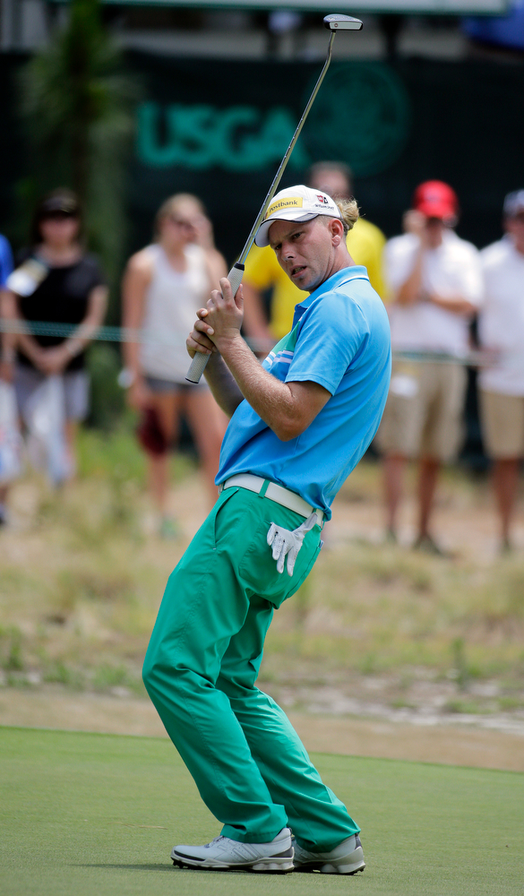 . Marcel Siem, of Germany, reacts after missing a putt on the fourth hole during the third round of the U.S. Open golf tournament in Pinehurst, N.C., Saturday, June 14, 2014. (AP Photo/Eric Gay)