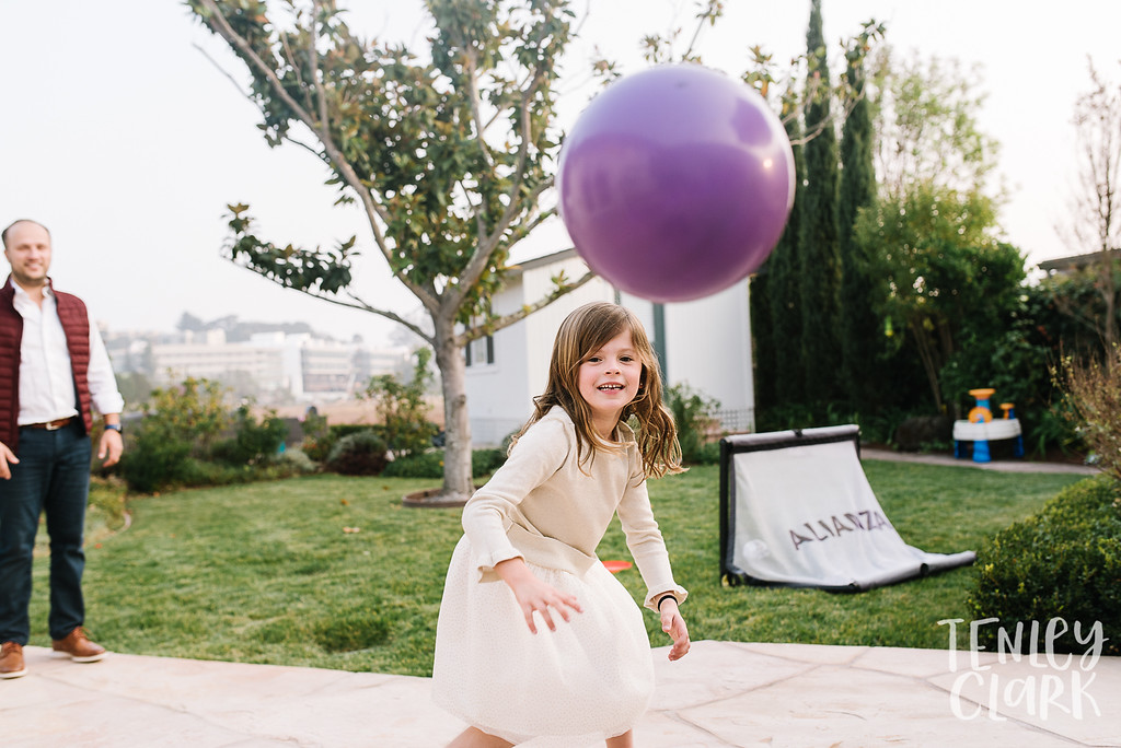 Girl playing ball with dad. Lifestyle in-home family photoshoot in Marin, CA by Tenley Clark Photography.