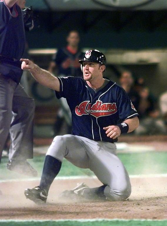 . Cleveland Indians\' Jim Thome celebrates scoring on a Chad Ogea single during the second inning of Game 6 of the World Series against the Florida Marlins Saturday, Oct. 25, 1997, at Miami\'s Pro Player Stadium. Indians Matt Williams also scored on the play. (AP Photo/Hans Deryk)