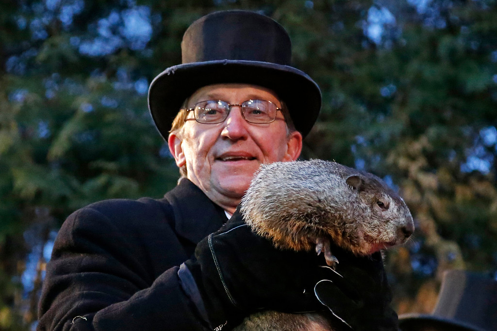 . Groundhog Club handler Ron Ploucha holds Punxsutawney Phil, the weather prognosticating groundhog, during the 131st celebration of Groundhog Day on Gobbler\'s Knob in Punxsutawney, Pa. Thursday, Feb. 2, 2017. Phil\'s handlers said that the groundhog has forecast six more weeks of winter weather. (AP Photo/Gene J. Puskar)