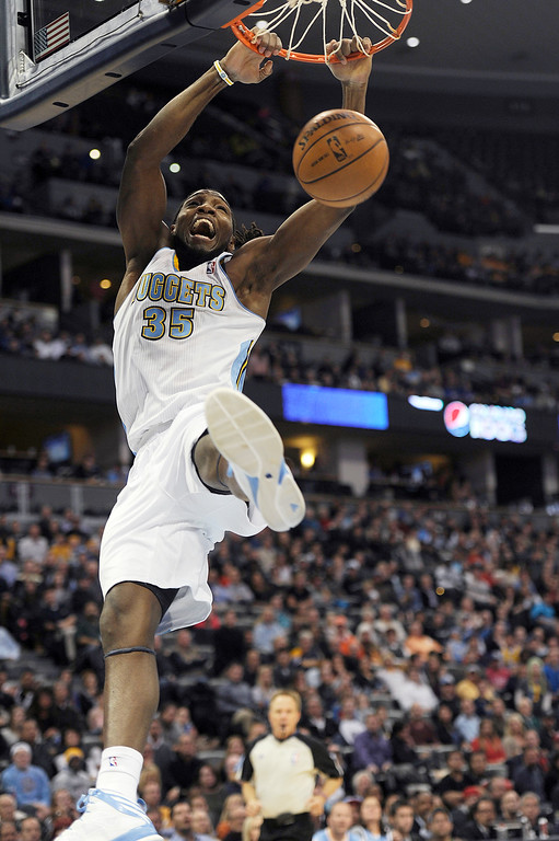 . Kenneth Faried #35 of the Denver Nuggets hits a slam dunk during the fourth quarter of an NBA game against the San Antonio Spurs at the Pepsi Center on November 5, 2013, in Denver, Colorado. (Photo by Daniel Petty/The Denver Post)