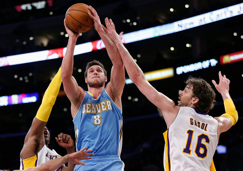 . Denver Nuggets\' Danilo Gallinari (C) of Italy goes to the basket between Los Angeles Lakers\' Kobe Bryant (L) and Pau Gasol (R) of Spain during the first half of their NBA basketball game in Los Angeles January 6, 2013. REUTERS/Danny Moloshok