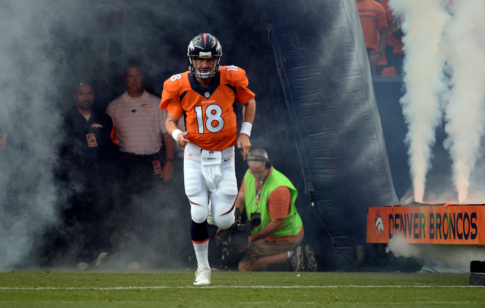 . Quarterback Peyton Manning (18) of the Denver Broncos runs onto the field prior to the start of the game. The Denver Broncos vs the Seattle Seahawks At Sports Authority Field at Mile High. (Photo by John Leyba/The Denver Post)
