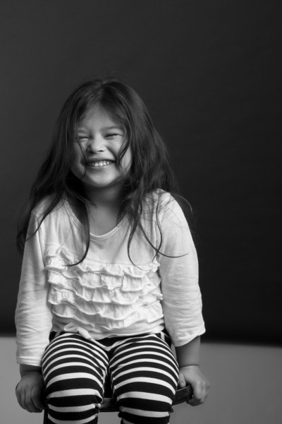 Laughing little girl black and white portrait by Jeanne McRight, Pix Photography