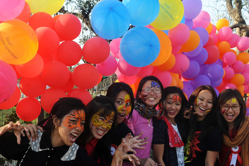 . Members and supporters of various sexual minority groups enjoy a moment during a protest meeting against all forms of physical and mental violence against women and girls all over the world, in Kolkata on February 14, 2013.  Indians were at the forefront of global protests on Thursday in the One Billion Rising campaign for women\'s rights, galvanised by the recent fatal gangrape that shocked the country.  DIBYANGSHU SARKAR/AFP/Getty Images