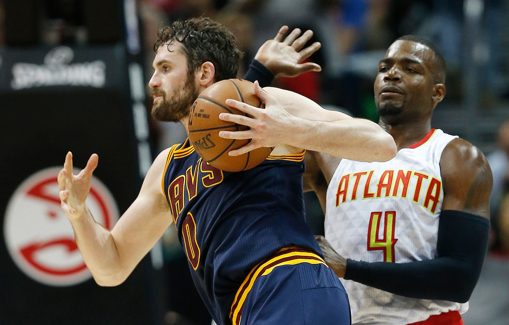 . Cleveland Cavaliers forward Kevin Love (0) moves past Atlanta Hawks forward Paul Millsap (4) in the first half of Game 4 of the second-round NBA basketball playoff series, Sunday, May 8, 2016, in Atlanta. (AP Photo/John Bazemore)
