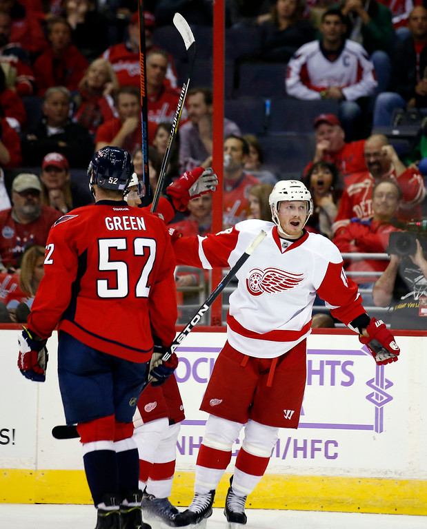 . Detroit Red Wings center Gustav Nyquist (14), from Sweden, celebrates his goal as Washington Capitals defenseman Mike Green (52) watches, in the second period of an NHL hockey game, Wednesday, Oct. 29, 2014, in Washington. (AP Photo/Alex Brandon)