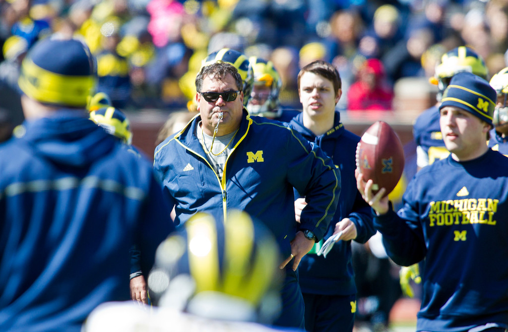 . Michigan head coach Brady Hoke, center, watches his players practice during the football team\'s annual spring game, Saturday, April 5, 2014, in Ann Arbor, Mich. (AP Photo/Tony Ding)