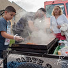Eight-year-old Andrew Garcia works the grill at his father's food cart near Santa Fe Drive in Denver during the First Friday Art Walk.