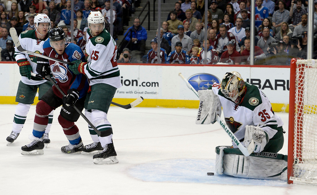 . DENVER, CO - APRIL 26: Minnesota Wild goalie Darcy Kuemper (35) looks at the puck in the crease during the first period of action. The Colorado Avalanche hosted the Minnesota Wild in the fifth round of the Stanley Cup Playoffs at the Pepsi Center in Denver, Colorado on Saturday, April 26, 2014. (Photo by John Leyba/The Denver Post)