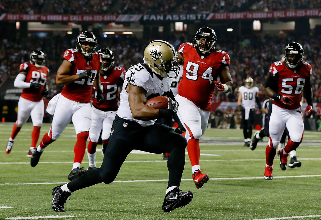 . Running back Pierre Thomas #23 of the New Orleans Saints carries the ball against the Atlanta Falcons during a game at the Georgia Dome on November 21, 2013 in Atlanta, Georgia.  (Photo by Kevin C. Cox/Getty Images)