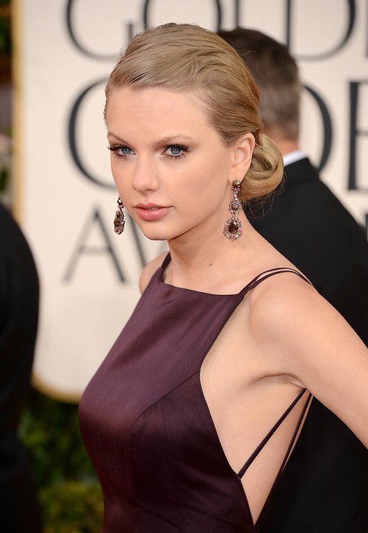 . Singer Taylor Swift\'s jewelry and make-up looked amazing on the red carpet, but her dress wasn\'t as great which is why she is a nominee for worst dressed at the 70th Annual Golden Globe Awards held at The Beverly Hilton Hotel on January 13, 2013 in Beverly Hills, California.  (Photo by Jason Merritt/Getty Images)