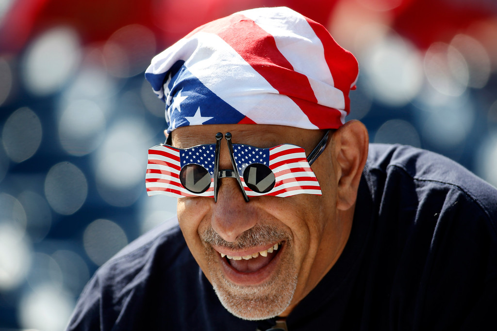 . George Hyder, from Annandale, Va., wears patriotic attire before a baseball game between the Washington Nationals and the Chicago Cubs at Nationals Park, Friday, July 4, 2014, in Washington. (AP Photo/Alex Brandon)