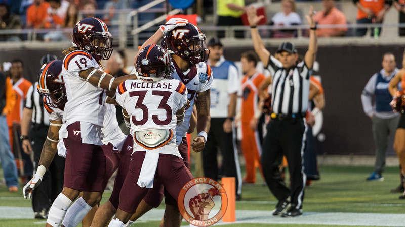 Josh Jackson (right) celebrates a touchdown with teammates in the Camping World Bowl between Virginia Tech and Oklahoma State in Orlando, Fl., Thursday, Dec. 28, 2017. (Special by Cory Hancock)
