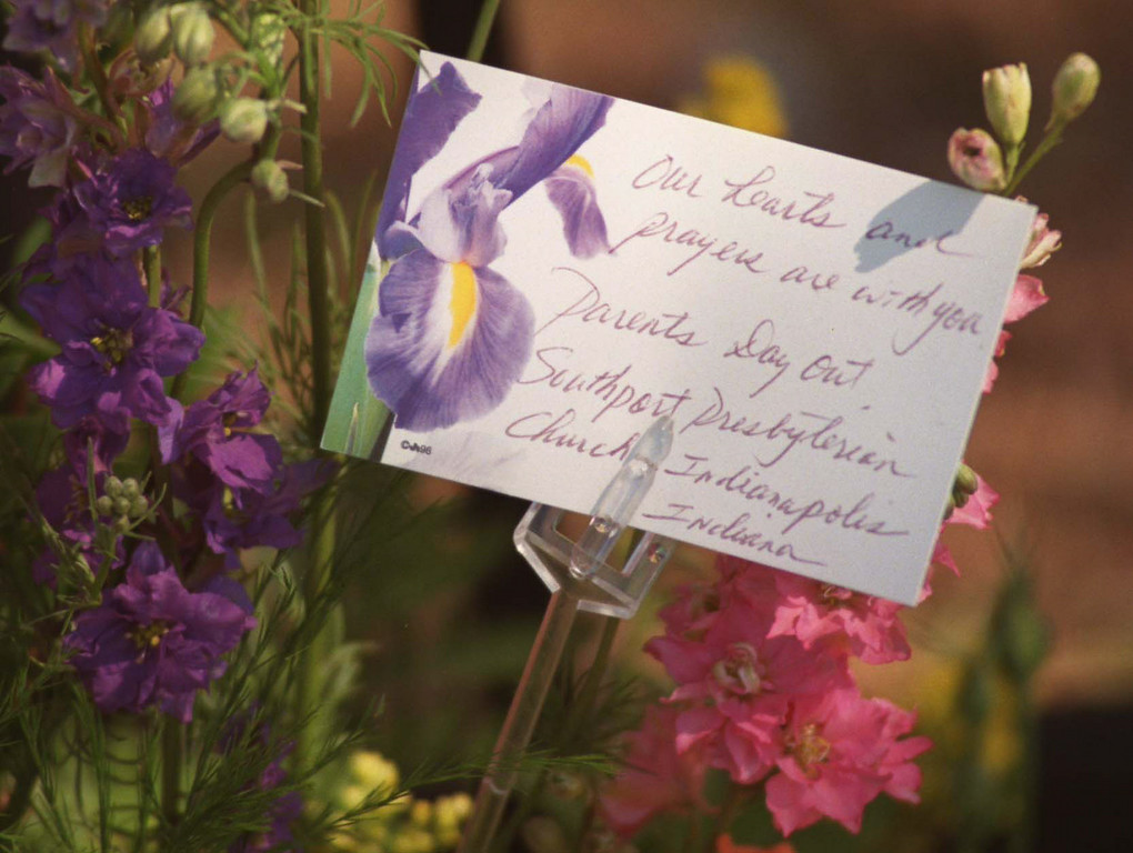 . A card with a message from a group in Indianapolis accompanies a bouquet of flowers placed in sympathy outside the Jewish Community Center in Granada Hills.   Los Angeles Daily News file photo.