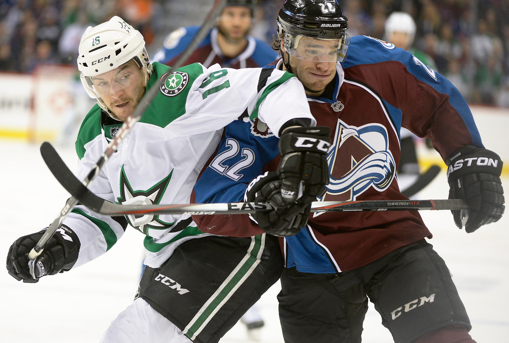 . Dallas Stars right wing Patrick Eaves (18) battles with Colorado Avalanche defenseman Zach Redmond (22) for the puck during the second period Saturday, February 14, 2015 at the Pepsi Center in Denver, Colorado. (Photo By Brent Lewis/The Denver Post)