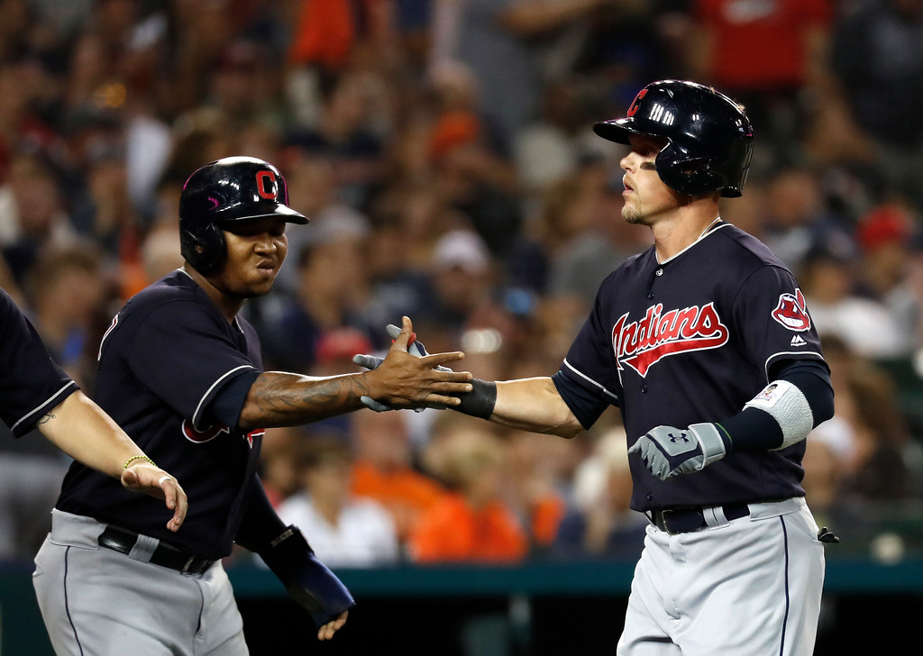 . Cleveland Indians right fielder Brandon Guyer, right, celebrates his three-run home run with Jose Ramirez in the eighth inning of a baseball game in Detroit, Friday, July 27, 2018. (AP Photo/Paul Sancya)