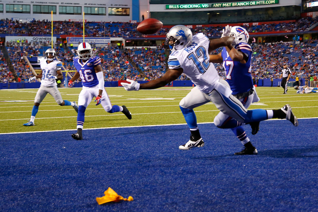 . A penalty flag lays in the end zone as Detroit Lions wide receiver Jeremy Ross (12) is unable to catch a pass while Buffalo Bills defensive back Sam Miller defends on the play during the first half of a preseason NFL football game, Thursday, Aug. 28, 2014, in Orchard Park, N.Y. (AP Photo/Bill Wippert)