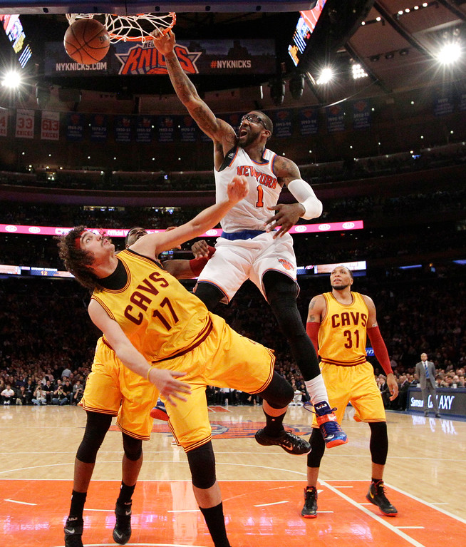 . New York Knicks forward Amar\'e Stoudemire (1) dunks over Cleveland Cavaliers center Anderson Varejao (17) as Cavaliers forward Shawn Marion (31) watches in the second half of an NBA basketball game at Madison Square Garden in New York, Thursday, Dec. 4, 2014. The Cavaliers won 90-87. (AP Photo/Kathy Willens)