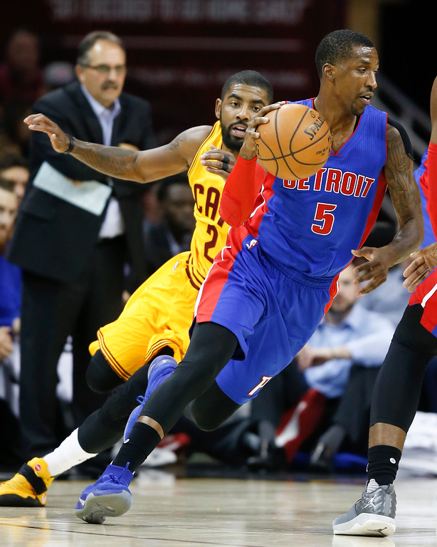 . Detroit Pistons\' Kentavious Caldwell-Pope (5) dribbles away from Cleveland Cavaliers\' Kyrie Irving (2) during the first half of an NBA basketball game Friday, Nov. 18, 2016, in Cleveland. (AP Photo/Ron Schwane)