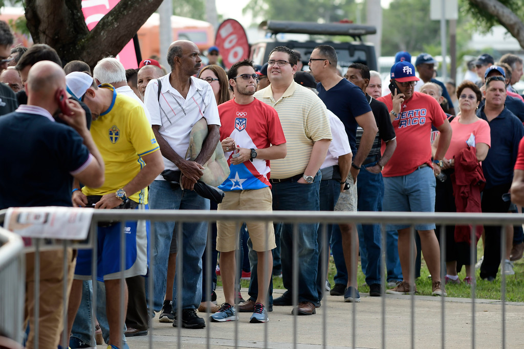 . Baseball fans waits to enter Hiram Bithorn Stadium for the final game of a two-game Mayor League Series between the Minnesota Twins and the Cleveland Indians in San Juan, Puerto Rico, Wednesday, April 18, 2018. (AP Photo/Carlos Giusti)