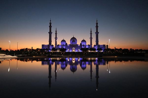 Sheikh Zayed Grand Mosque in Abu Dhabi, UAE, lit up at dusk