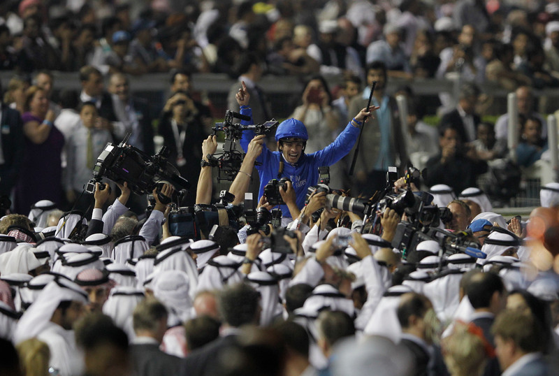 . Silvestre De Sousa, riding African Story from Britain, celebrates after winning the world\'s richest horse race Dubai World Cup at Meydan racecourse in Dubai, United Arab Emirates, Saturday, March 29, 2014. (AP Photo/Kamran Jebreili)