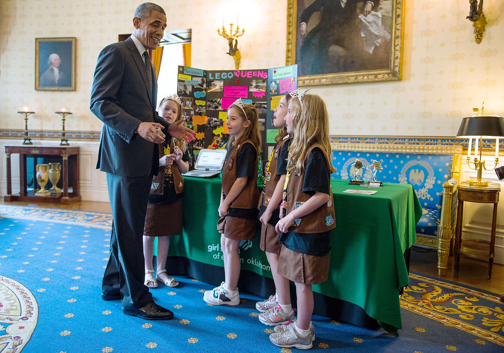 ". US President Barack Obama (L) talks with a Girl Scout Brownie troop from Tulsa, Oklahoma about their design for a ""flood proof\"" bridge, during the White House Science Fair at the White House in Washington, DC, May 27, 2014.  The White House Science Fair celebrates the student winners of a broad range of science, technology, engineering and math (STEM) competitions from across the country.       AFP PHOTO / Jim WATSON/AFP/Getty Images"