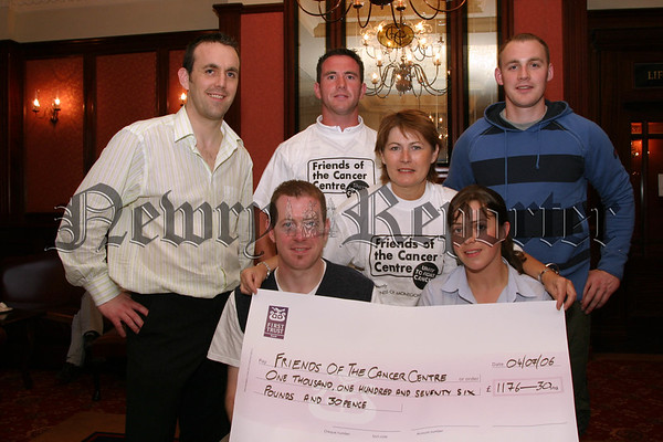 Friends of the Cancer Care Unit in Belfast City Hospital, Some of the people who took part in the Belfast relay Marathon and raised a grand total of £1176-30 for Cancer Centre, Included are Sean Grant, Thomas Fitzpatrick, Michael Fitzpatrick, Ciaran Byrne and Martina Doyle presenting the to Coleen Shaw (fundraising manager) standing centre,missing from photo are Ciaran Doyle and Dianne Crawford.  06W28N53