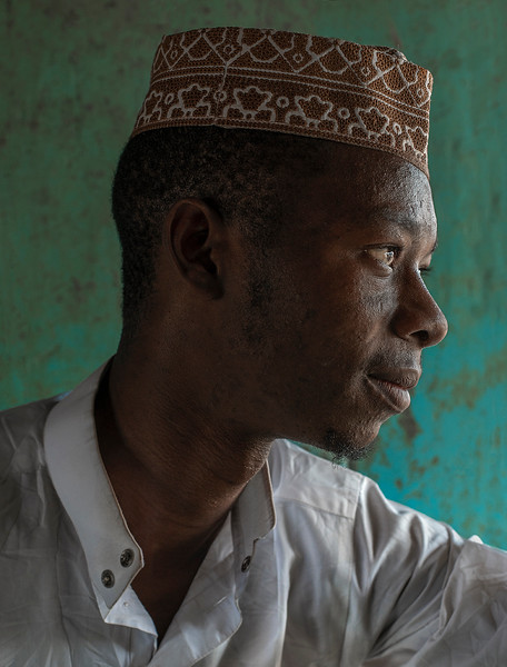 Portrait of a muslim man wearing the traditional hat.   Tanzania, 2019.
