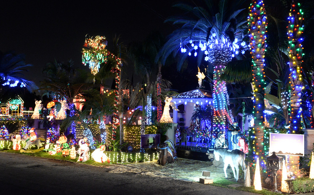 . Holiday lights on display at one of three houses on the 8200-block of La Bajada Ave. in Whittier on Friday December 20, 2013. (Staff Photo by Keith Durflinger/Whittier Daily News)