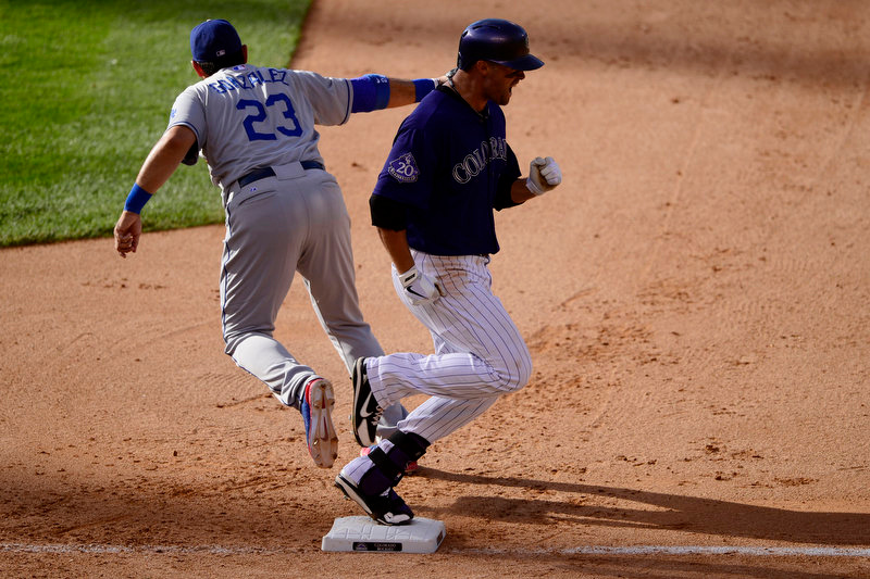 . Adrian Gonzalez (23) of the Los Angeles Dodgers makes the out as Michael Cuddyer (3) of the Colorado Rockies shouts after hitting into a double play during the Dodgers\' 10-8 win in Denver on Monday, September 2, 2013. The Colorado Rockies hosted the Los Angeles Dodgers at Coors Field. (Photo by AAron Ontiveroz/The Denver Post)