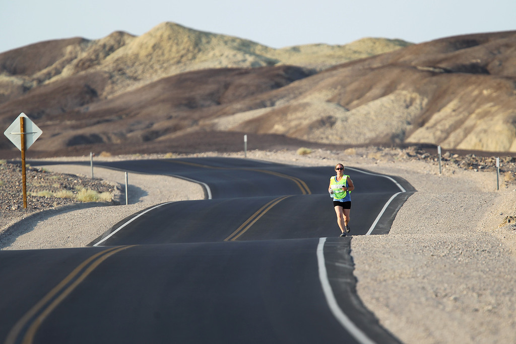 . Death Valley National Park employee Anna Gilay makes her usual seven-mile morning run at 6:55 a.m. with the unofficial temperature already reaching 103 degrees as a heat wave spreads across the American West on June 30, 2013 in Death Valley National Park, California.    (Photo by David McNew/Getty Images)