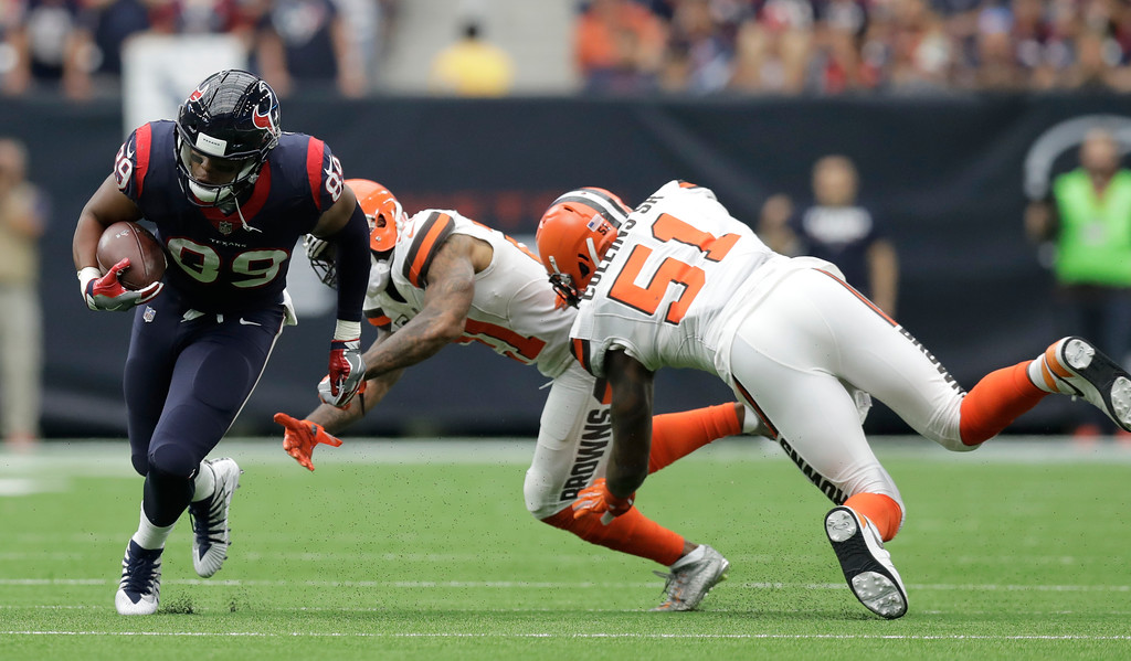 . Houston Texans tight end Stephen Anderson (89) evades tackle attempt by Cleveland Browns cornerback Jamar Taylor (21) and Jamie Collins Sr. (51) in the first half of an NFL football game, Sunday, Oct. 15, 2017, in Houston. (AP Photo/Eric Gay)