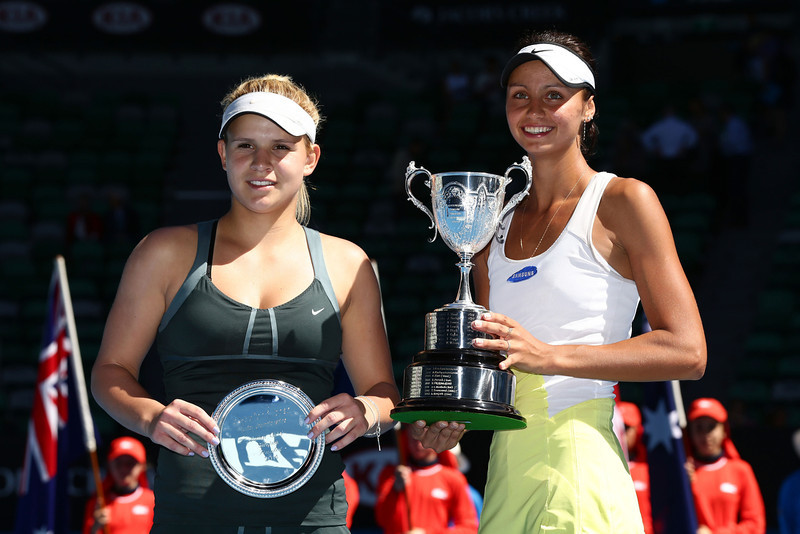 . Elizaveta Kulichkova (R) of Russia poses with the winners trophy and Jana Fett of Croatia poses with the runner up trophy after their Junior Girls\' Singles Final during day 13 of the 2014 Australian Open at Melbourne Park on January 25, 2014 in Melbourne, Australia.  (Photo by Matt King/Getty Images)