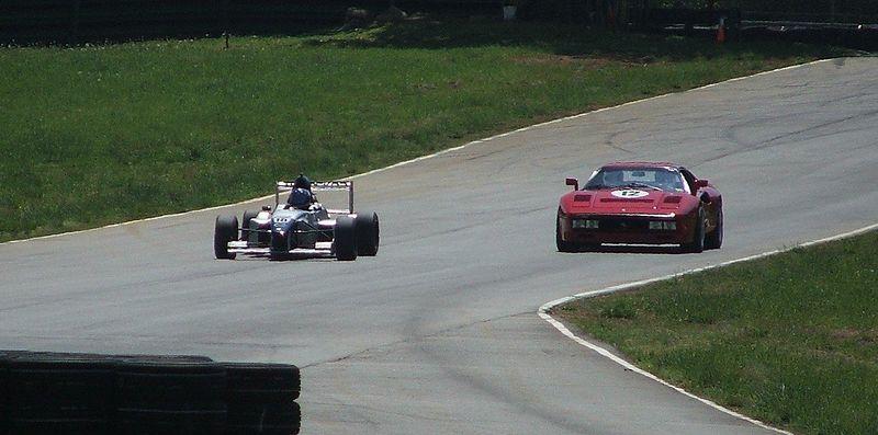 288 GTO racing an open wheel car