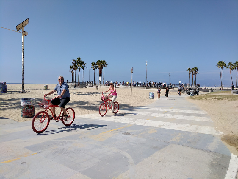Cycling by the skate park in Venice Beach.