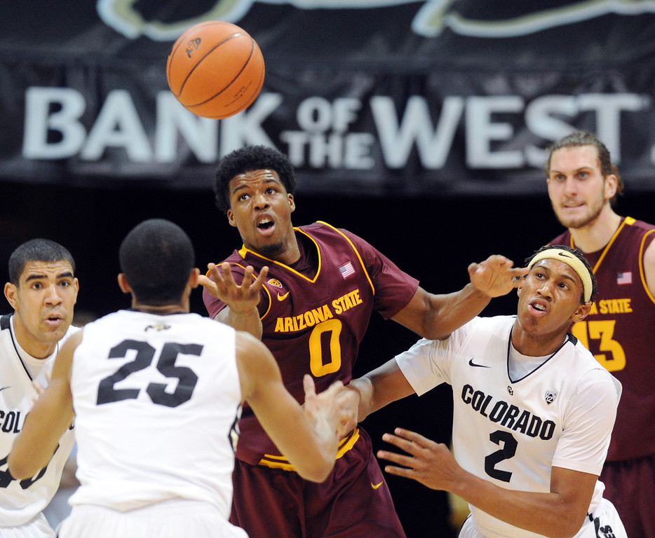 . Arizona State\'s Carrick Felix (0) tries to control a tipped ball in front of Colorado\'s Xavier Johnson (2) during the first half of an NCAA college basketball game on Saturday, Feb. 16, 2013, in Boulder, Colo. (AP Photo/Daily Camera, Cliff Grassmick)