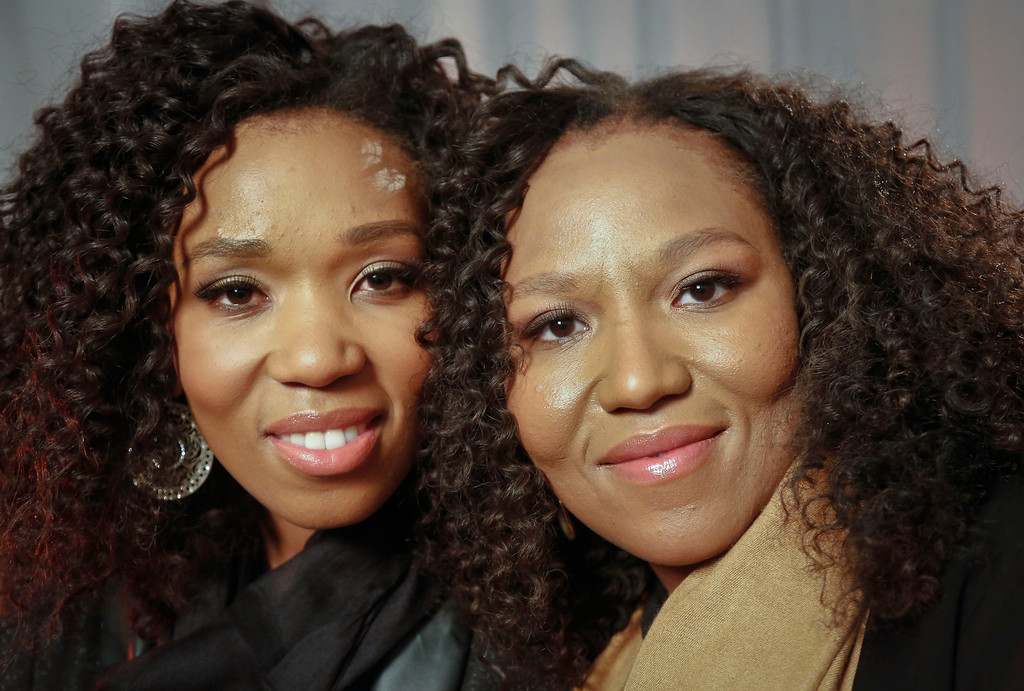 ". In this Wednesday, Feb. 6, 2013 photo, Swati Dlamini, left, and Zaziwe Dlamini-Manaway, granddaughters of Nelson and Winnie Mandela, pose during an interview in New York.  The sisters are stars of  the new reality show ""Being Mandela,\"" produced by COZI TV for NBC.  The 30-minute weekly show premieres on Sunday, Feb. 10 at 9 PM ET and will follow the next generation of Mandela family through the experiences of sisters Zaziwe and Swati and their families.  (AP Photo/Bebeto Matthews)"