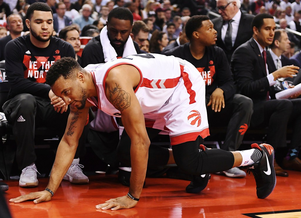 . Toronto Raptors guard Norman Powell (24) falls to the floor after leaving with an injury during the first half of Game 3 of an NBA basketball second-round playoff series against the Cleveland Cavaliers in Toronto on Friday, May 5, 2017. (Frank Gunn/The Canadian Press via AP)