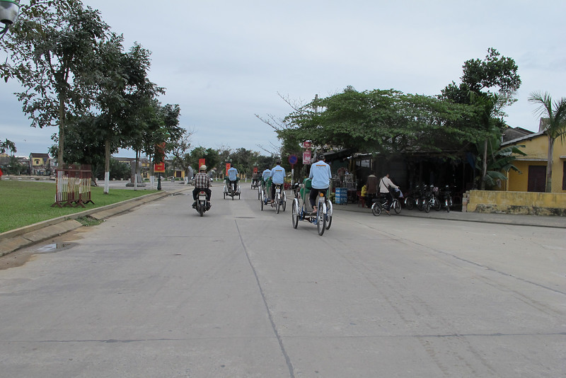 Cyclos rolling into Hoi An's central area.