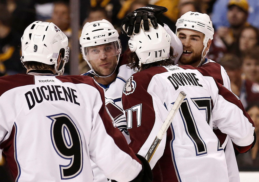 . Colorado Avalanche\'s Ryan O\'Reilly, right rear, celebrates his goal against the Boston Bruins with teammates, left to right, Matt Duchene, Matt Duchene and Steve Downie during the first period of the Avalanche\'s 2-0 win in an NHL hockey game in Boston on Thursday, Oct. 10, 2013. (AP Photo/Winslow Townson)