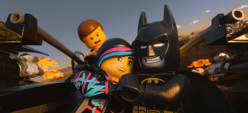 """. FILE - This image released by Warner Bros. Pictures shows characters, from left, Emmet, voiced by Chris Pratt, Wyldstyle, voiced by Elizabeth Banks and Batman, voiced by Will Arnett, in a scene from \""""The Lego Movie.\"""" The film was nominated for a Golden Globe for best animated feature on Thursday, Dec. 11, 2014. The 72nd annual Golden Globe awards will air on NBC on Sunday, Jan. 11.  (AP Photo/Warner Bros. Pictures, File)"""
