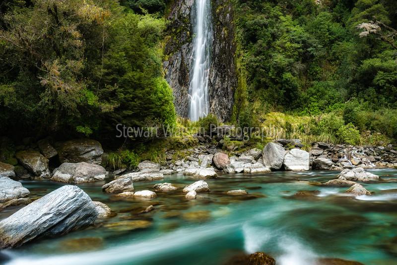 Spectacular waterfall in bush at Thunder Creek Falls, Haast Mt Aspiring National Park New Zealand