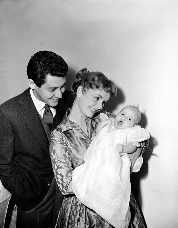 . Actress Debbie Reynolds and her husband, singer Eddie Fisher, pose with their ten-week-old daughter Carrie Frances for the first family picture, January 2, 1957, in Hollywood, California. (AP Photo)